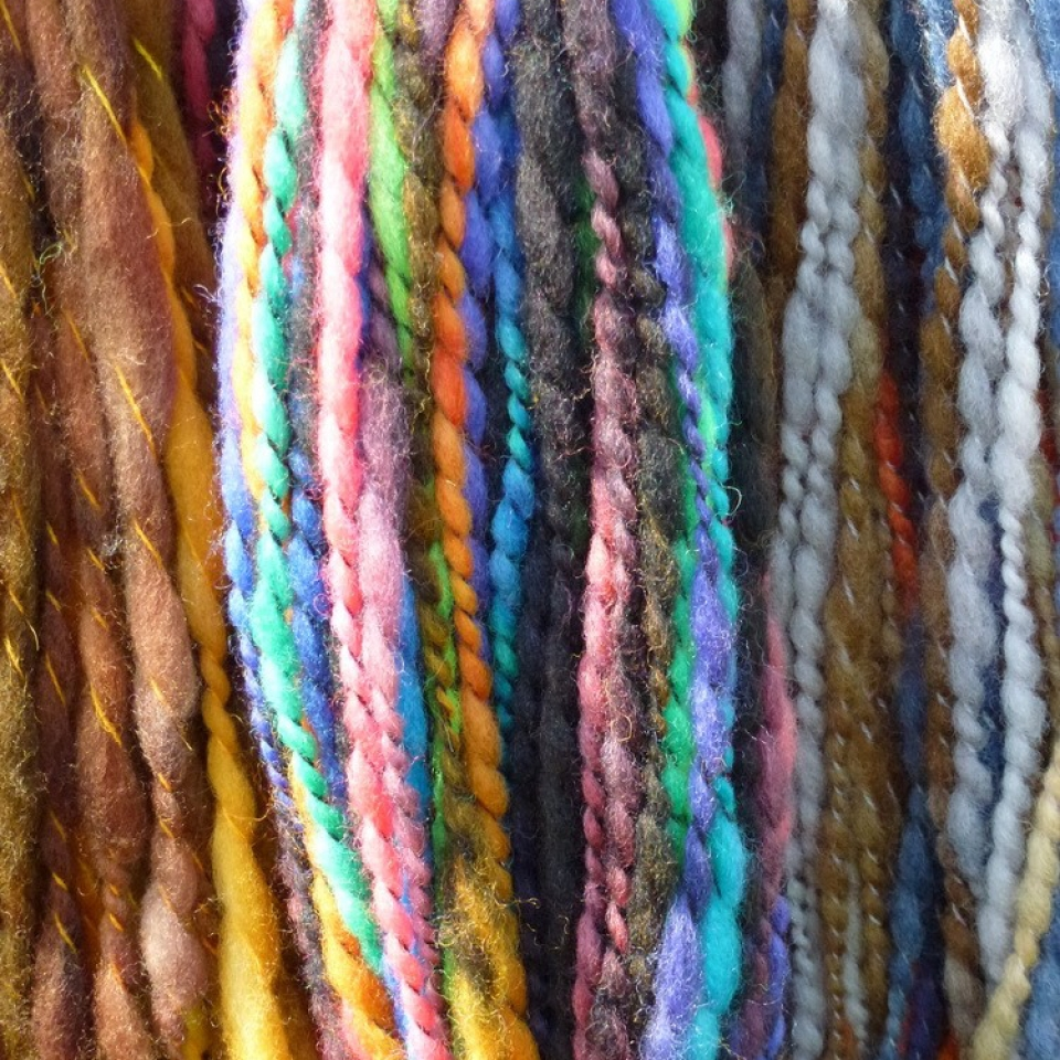 yarn strands at Fibrations